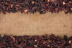 Dried hibiscus flowers petals lies on sackcloth Royalty Free Stock Images