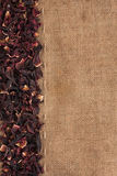 Dried hibiscus flowers petals lies on sackcloth Royalty Free Stock Photos
