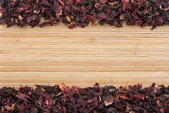 Dried  hibiscus  on  a  light  bamboo mat Stock Photography