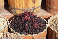 Dried hibiscus petals in wooden container on street stall Royalty Free Stock Photo