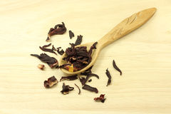 Dried Hibiscus petals in a wooden spoon Royalty Free Stock Photography