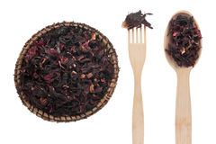 Dried hibiscus  in a plate, fork and spoon Stock Photos