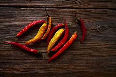Dried hot chili peppers on aged wood Stock Photo