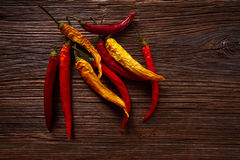 Dried hot chili peppers on aged wood Stock Photos
