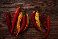Dried hot chili peppers on aged wood Royalty Free Stock Images