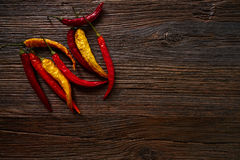 Dried hot chili peppers on aged wood Stock Images