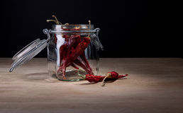 Dried hot red chillies in glass jar Royalty Free Stock Photography