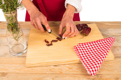 Chopping hot peppers Royalty Free Stock Photo