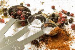 Dried ingredients and measure spoons Stock Image