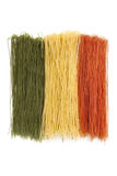 Dried Italian pasta. Dried spaghetti arranged in Italian flag colors - green white and red Stock Images