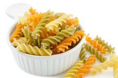 Dried italian pasta (macaroni) in white bowl. Stock Photos