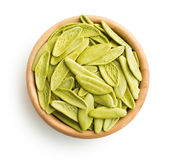 Dried italian pasta with spinach flavour. Royalty Free Stock Images
