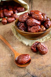 Dried jujube fruit on wooden table Royalty Free Stock Photo