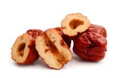 Dried jujube fruits on white background royalty free stock image