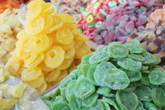 Dried kiwi, pineapple and sweet candies sold at an Arabic market stall royalty free stock images