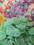 Dried kiwi and sweet candies sold at an Arabic market stall Stock Image