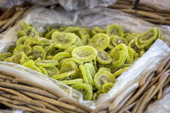 Dried Kiwis. Dried slices of kiwi fruit in a basket on a market in France royalty free stock photo