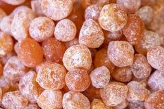 Dried kumquats Sweet background Royalty Free Stock Image