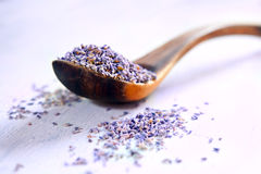 Dried lavender. In a wooden spoon on a rustic table Stock Photos