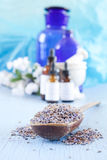 Dried lavender. On a wooden spoon with eyedropper bottles in the background Royalty Free Stock Images