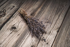 Dried lavender bouquet on grungy wooden background Stock Photo