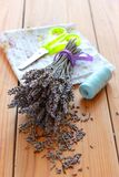 Dried lavender bouquet, scissors and cloth Royalty Free Stock Photos