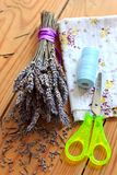 Dried lavender bouquet, scissors and cloth Royalty Free Stock Images