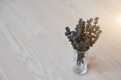 Dried lavender branches at vase at white wooden background Stock Photography