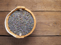 Dried lavender in bucket on wooden background Stock Photo