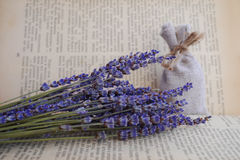 Dried lavender and canvas bag in front of vintage book Royalty Free Stock Photo