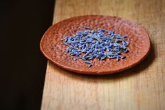 Dried lavender in a clay bowl stock images