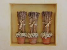 Dried lavender flowers in three vases. Dried lavender vases over yellow background in an italian house Royalty Free Stock Image
