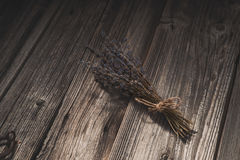 Dried lavender on old wooden background Royalty Free Stock Images
