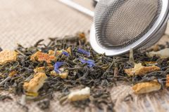 Dried leaves of herbal green tea with the addition of citrus peel and blue flowers royalty free stock image