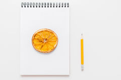 Dried lemon picture in notepad, pencil, free space Royalty Free Stock Image