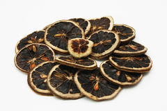 Dried Lemon Slices. Some pieces of dried lemon sliecs with white background Royalty Free Stock Images