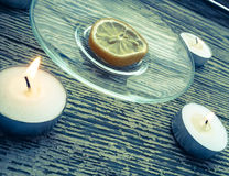 The dried lemon is surrounded of candles Royalty Free Stock Image