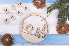 Dried lemons, ball and New Year`s greetings. Dried lemons, Santa and New Year`s greetings. Wooden Christmas ball and decorations. Creative bright New Year card royalty free stock images