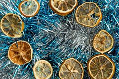 Dried lemons and tinsel royalty free stock photos
