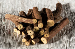 Dried licorice sticks. Made from the sweet flavored roots of the Glycyrrhiza glabra plant used as a flavoring in cooking and candy cut to lengths and arranged Royalty Free Stock Photo