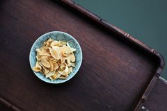 Dried lily in bowl stock photos