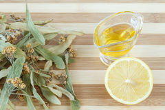Dried lime blossom, honey and lemon for cold and flu treatment Royalty Free Stock Photos