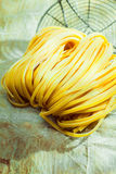 Dried linguine Italian pasta in a country kitchen Stock Photography