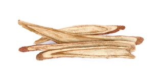 Dried Liquorice roots on a white background. royalty free stock photo