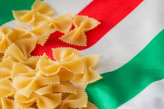 Dried Macaroni on the background of the Italian flag colors. for backdrop, substrate, composition use, place for your Stock Images
