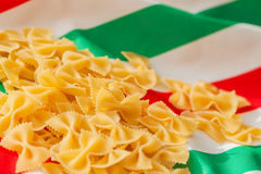 Dried Macaroni on the background of the Italian flag colors, place for your text Royalty Free Stock Photo