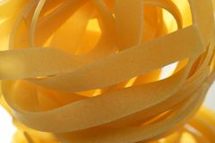 Dried macro noodles yellow pasta, studio shot Royalty Free Stock Photography