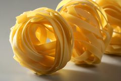 Dried macro noodles yellow pasta, studio shot Stock Images