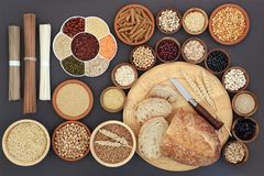 Dried Macrobiotic Diet Food. Dried macrobiotic diet health food concept with sourdough bread, soba and udon noodles, legumes, seaweed, grain, cereal, seeds and royalty free stock images