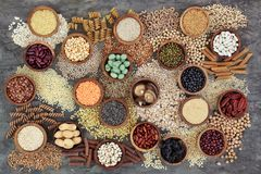 Dried Macrobiotic Diet Health Food. Dried macrobiotic health food with grains, cereals, pulses, nuts, seeds and whole wheat pasta. Super foods high in smart stock photo